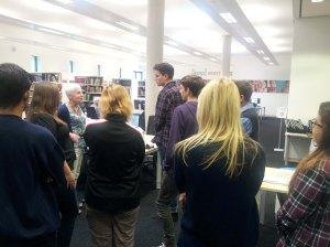 students listening to Liz