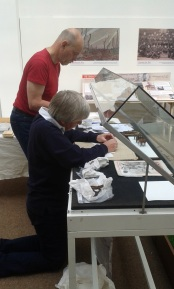 Volunteers install objects for the exhibition.