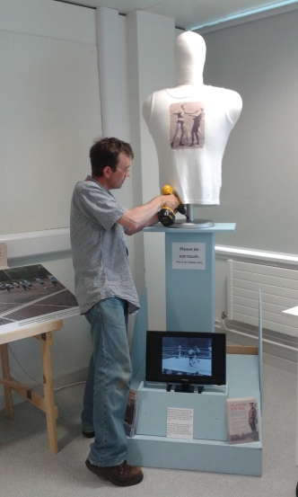 Hamish installs the boxing dummy.
