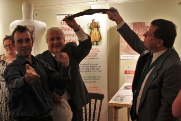 Worthing Mayor Michael Donin and Chairman of Adur Carson Albury holding up our latest find, a 1918 pick head found on Slonk Hil.